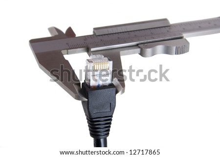 Caliper measuring computer network cable - stock photo