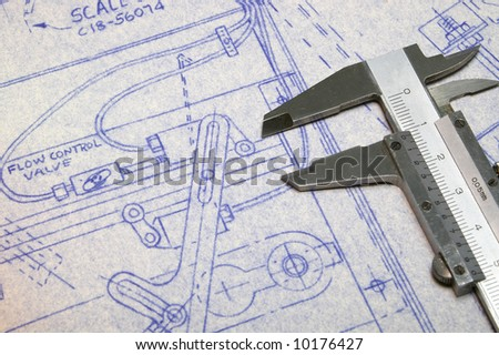Calipers and Blueprint - stock photo