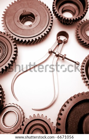 Calipers and cogwheels - stock photo