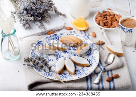 Calissons d'Aix-en-Provence on a ceramic plate on a white wooden background. Traditional French Provence sweets. - stock photo