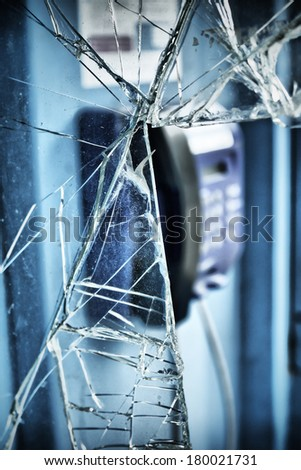Call-box with a crushed window - stock photo