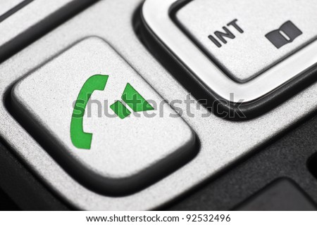 Call button on a cordless phone - stock photo