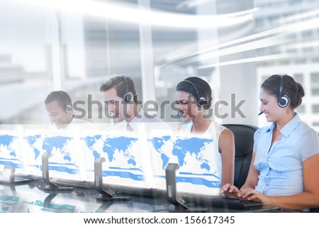 Call center employees at work on futuristic holograms in bright modern office - stock photo