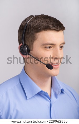 Call center male operator isolated on white. Closeup portrait of young man with headset isolated on white background  - stock photo