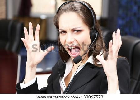 Call center operator at work  - stock photo