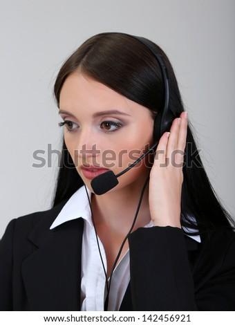 Call center operator, on gray background - stock photo