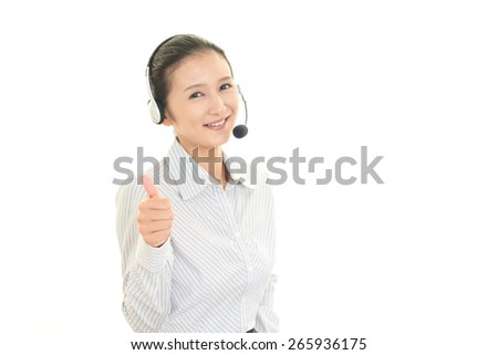 Call center operator showing thumbs up sign - stock photo