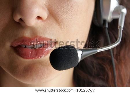 Call center operator using hands-free - stock photo