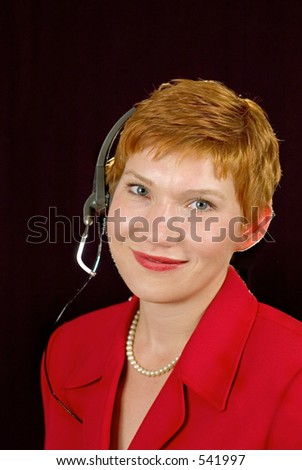 Call center operator with headset and pearl necklace.