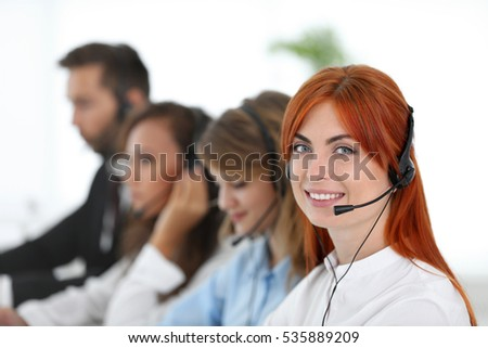 Call center operator with her colleagues