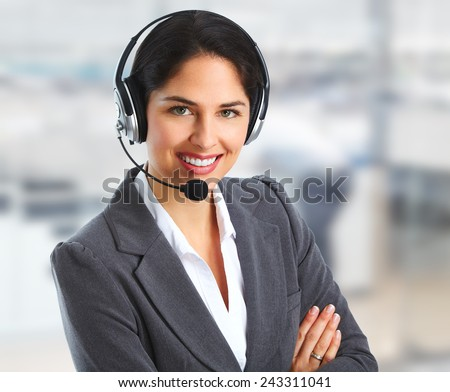 Call center operator Woman with headsets talking with client - stock photo