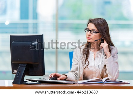 Call center operator working in the office - stock photo