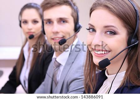 Call center operators at work - stock photo