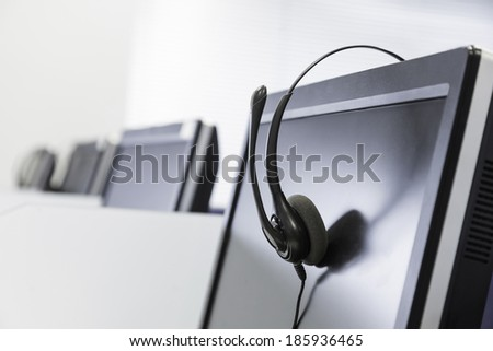 call center telephony headset isolated on screen - stock photo