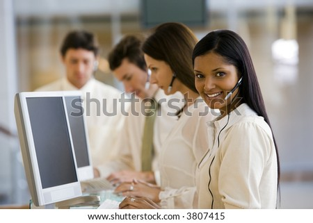 Call center with smiling woman - stock photo