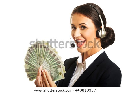Call center woman holding polish bills - stock photo