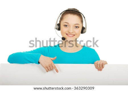 Call center woman pointing on billboard. - stock photo