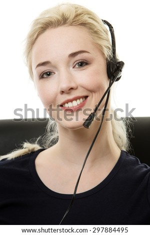 call center woman sitting at her desk on a call - stock photo