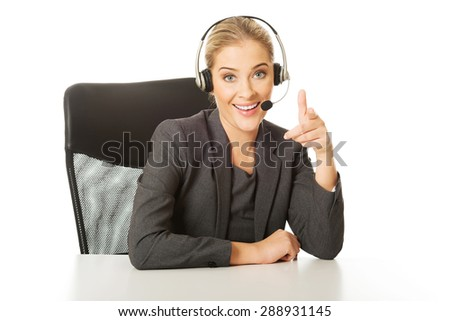 Call center woman sitting at the desk.