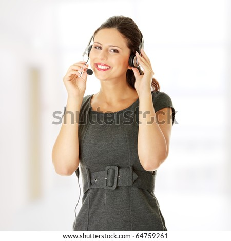 Call center woman with headset. - stock photo