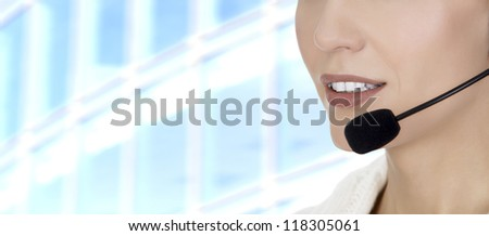 Call center woman with headset against abstract background - stock photo