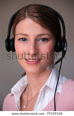 Call center woman with headset. Beautiful smiling caucasian woman - stock photo