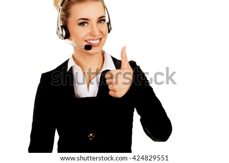 Call center woman with headset gesturing OK - stock photo