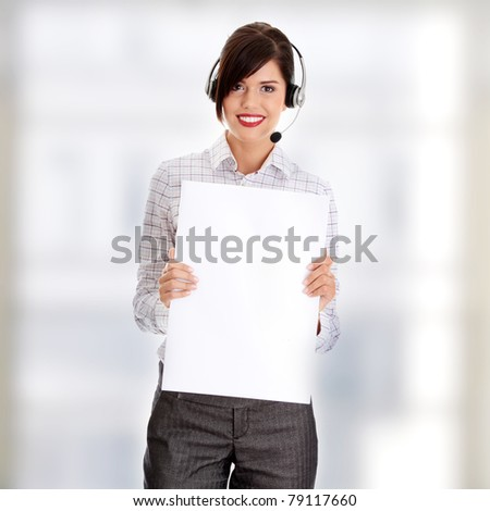 Call center woman with headset holding blank sign.