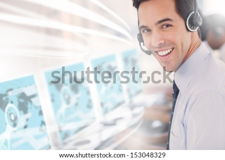 Call center worker using futuristic interface hologram smiling at camera in office - stock photo