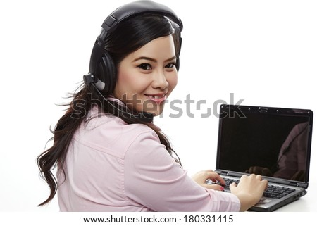 Call centre and technology concept - female helpline operator with headphones and laptop pc