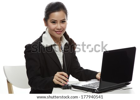 Call centre and technology concept - female helpline operator with microphone and laptop pc