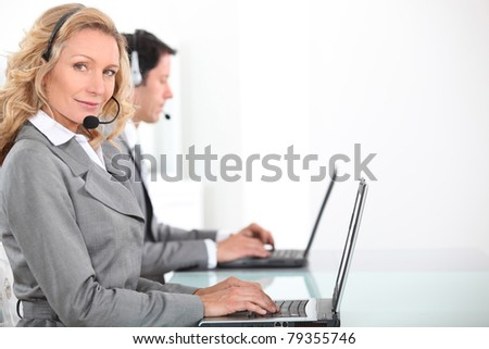 Call centre workers - stock photo