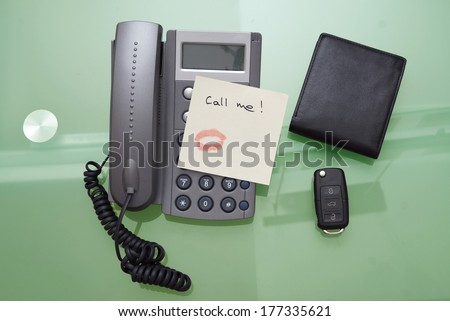 Call me written on a ticket on the phone - stock photo