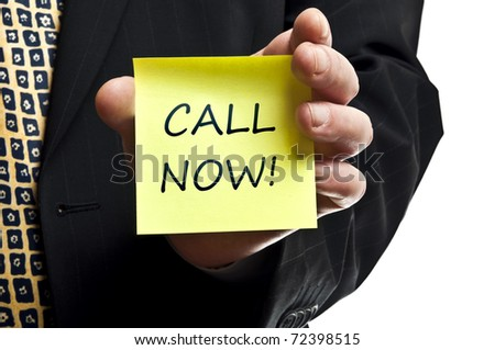 Call now post it in business man hand - stock photo