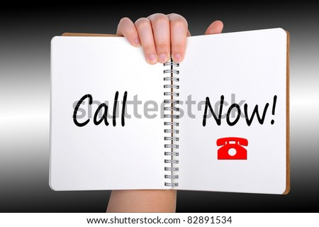 Call Now words on book - stock photo