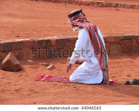 Call to Prayer on the red sands of Wadi Rum, Jordan - stock photo
