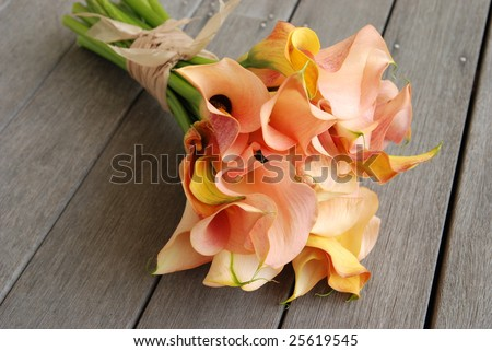 Calla Lilly Wedding Bouquet on deck - stock photo