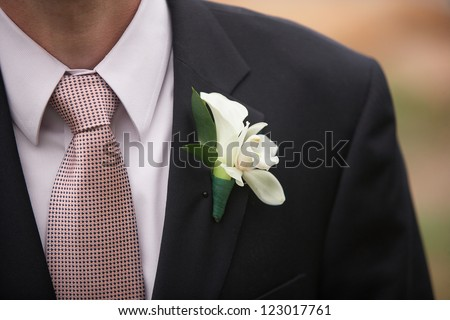 Calla Lily Boutonniere on Wedding Groom Suit Jacket