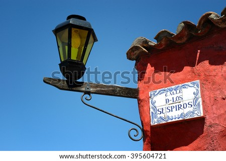 Calle de Los Suspiros Lamp in Colonia Uruguay - stock photo