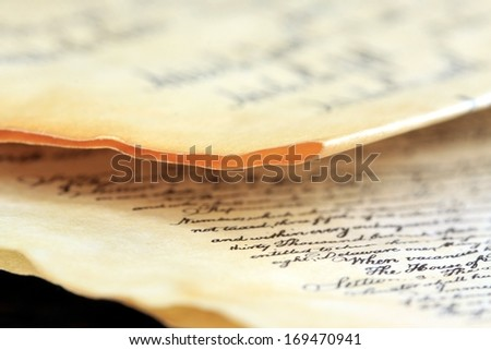 Calligraphy handwriting on old vintage paper - stock photo