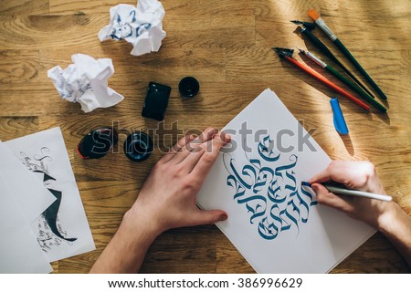 calligraphy master workplace - stock photo