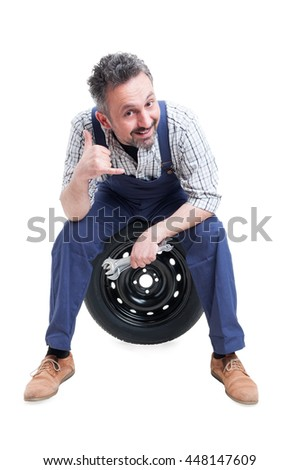 Calling concept with handsome mechanic with spanner doing a gesture with hand isolated on white background - stock photo