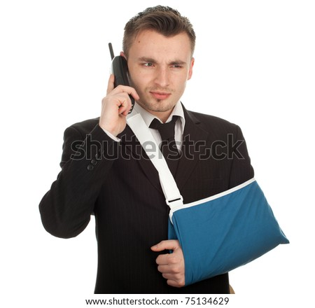 calling young businessman with broken hand wearing an arm brace, series - stock photo