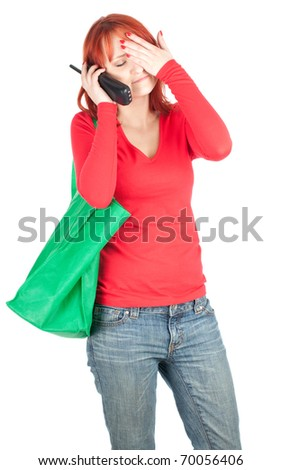 calling young woman with green ecological shopping bag - stock photo
