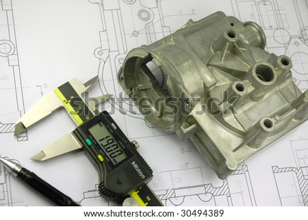 calliper and mechanical part on engineering drawing - stock photo