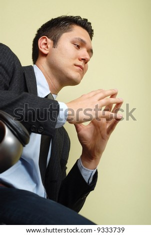 Calm and composed businessman making up his mind - stock photo