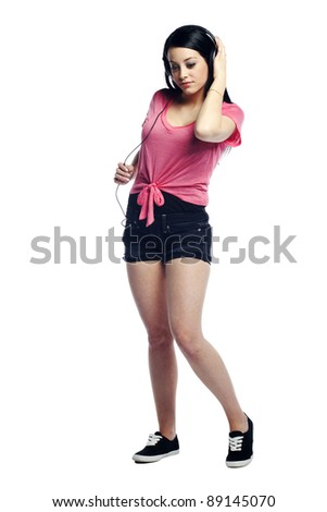 Calm and confident young woman listening to music in the moment - stock photo