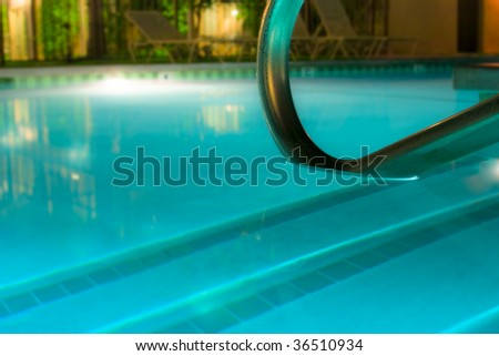 Calm and empty poolside at night - stock photo