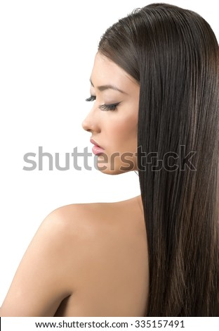 Calm Asian young woman with long medium brown hair - Isolated - stock photo