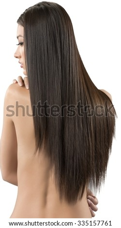 Calm Asian young woman with long medium brown hair with hands covering chest - Isolated